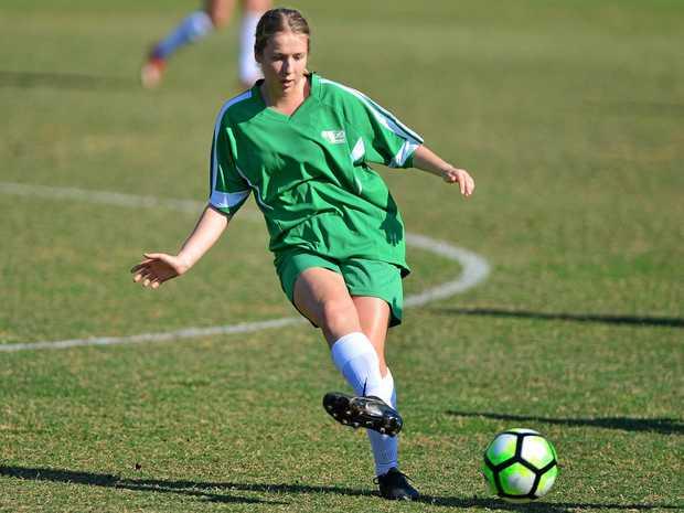 VALIANT: Sunshine Coast's Martha Bensted in action against Brisbane.