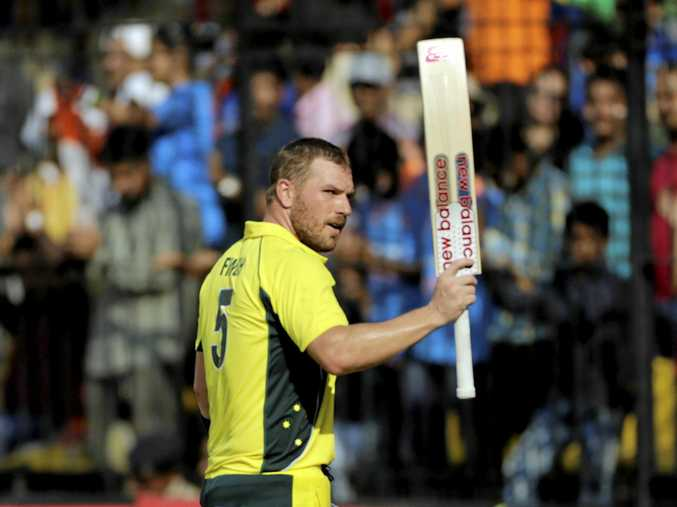 Aaron Finch raises his bat after scoring his eighth ODI ton.