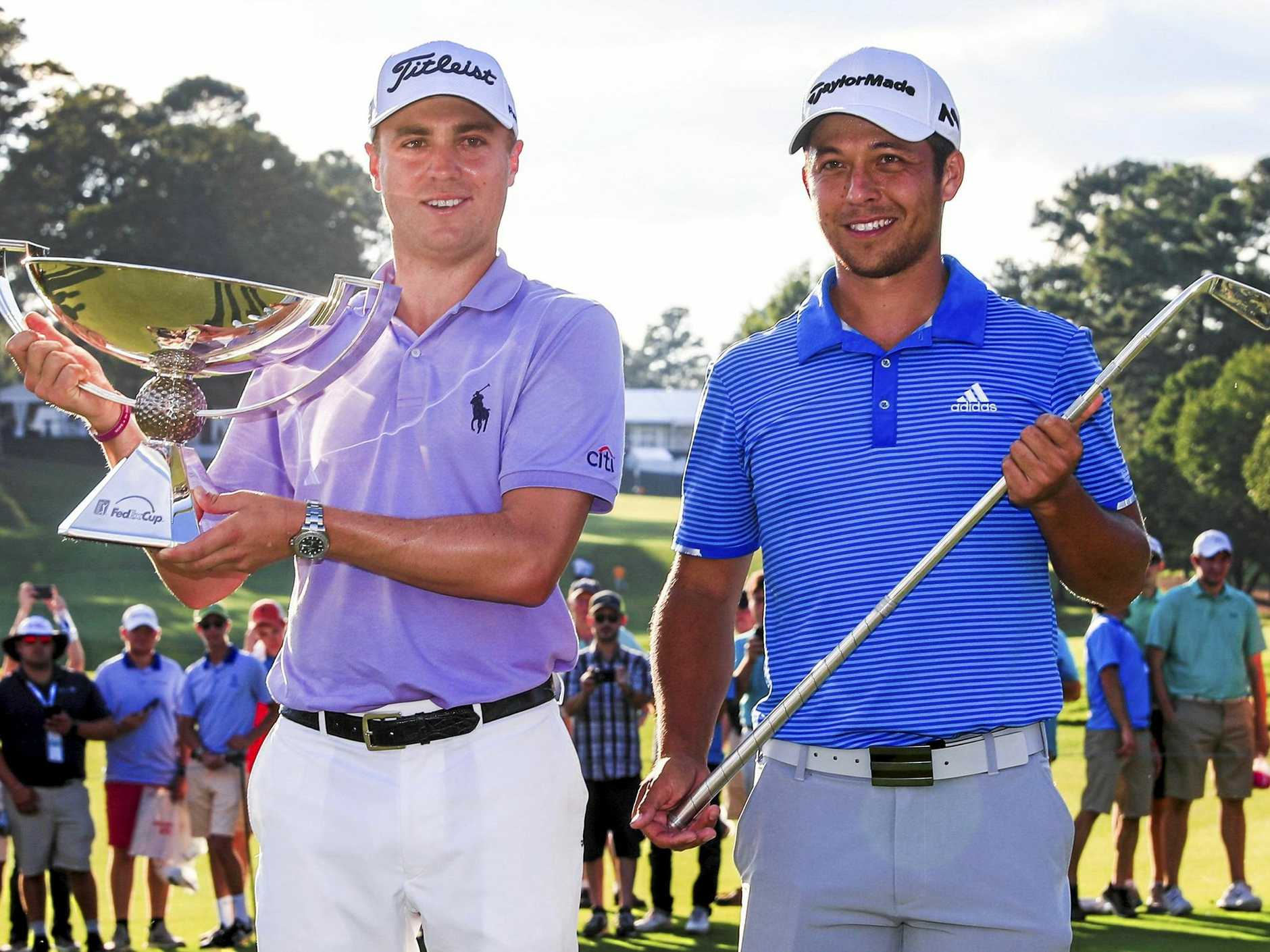 Justin Thomas shows of the FedEx Cup and Xander Schauffele (right) of the Tour Championship trophy after the season-ending tournament in Atlanta.