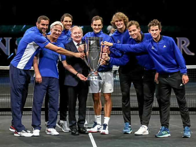 Members of the Team Europe hold the trophy as they celebrate winning the Laver Cup tennis tournament in Prague with Rod Laver.