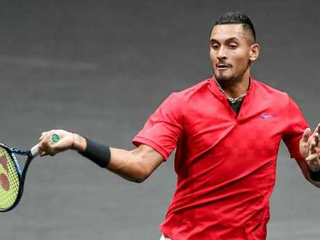Australia's Nick Kyrgios in action against Roger Federer.