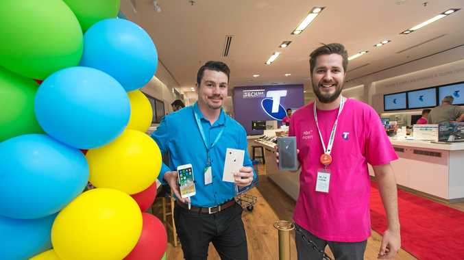 Telstra Coffs Harbour Park Beach store staff Tyson Wicks and Lucan McGowan with the new iPhones.