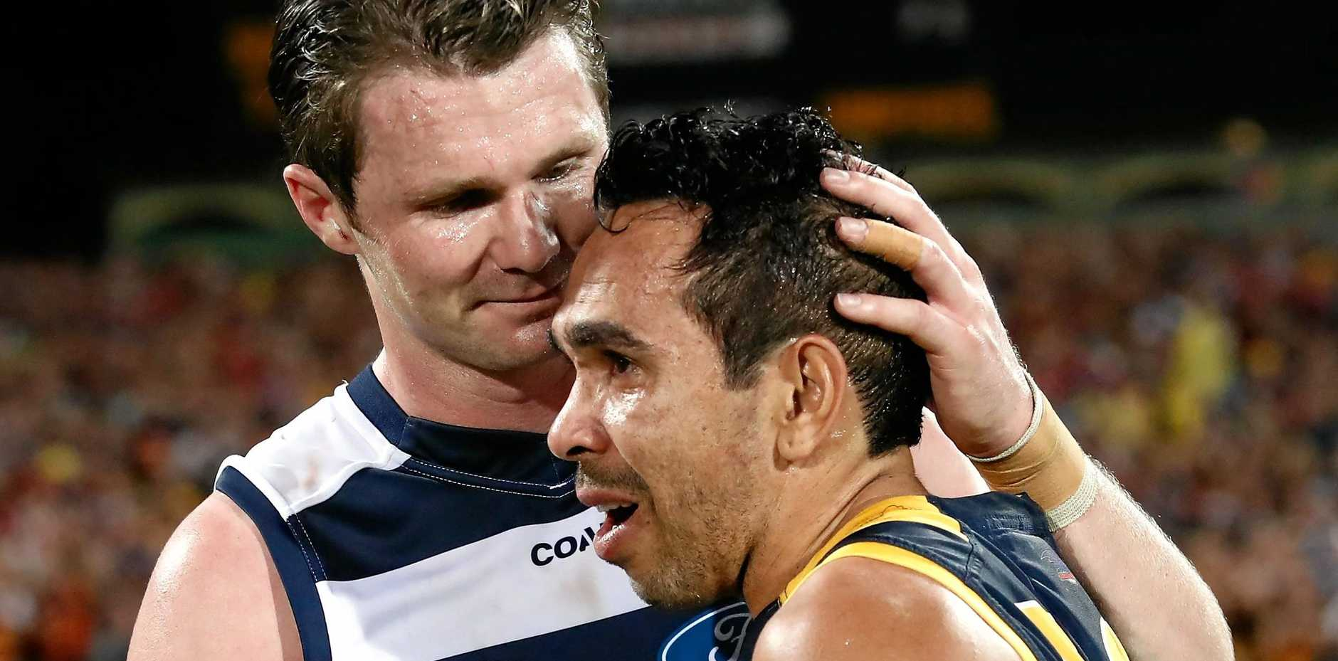 WELL DONE MATE: Patrick Dangerfield congratulates former Crows teammate Eddie Betts.