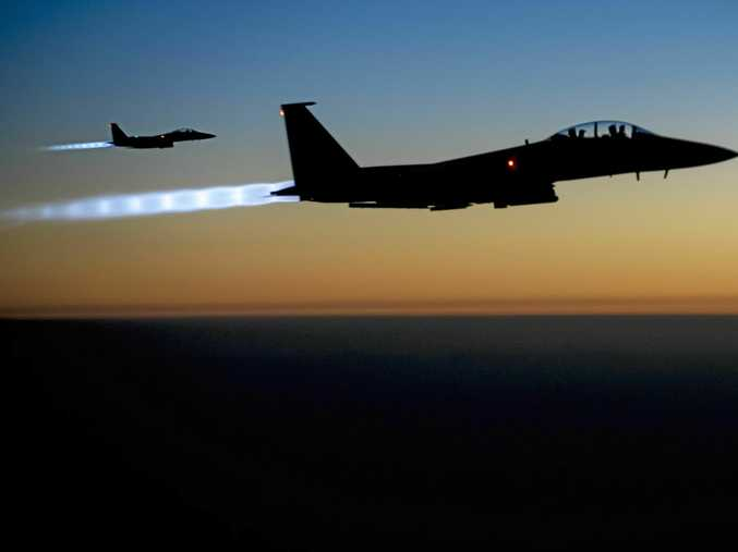 Two US F-15E Strike Eagle fighters fly over northern Iraq after conducting air strikes.