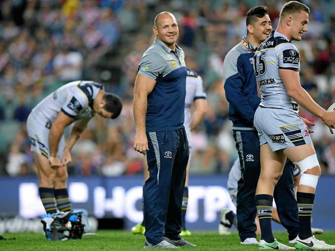 Matt Scott  looks on as his team warms up ahead of the NRL Preliminary Final
