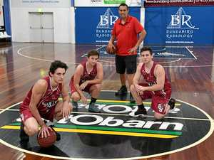 Bundaberg Bulls coach Mick Catlin with Ben Wright, Daniel Gardner and Shayne Mayes earlier this year.