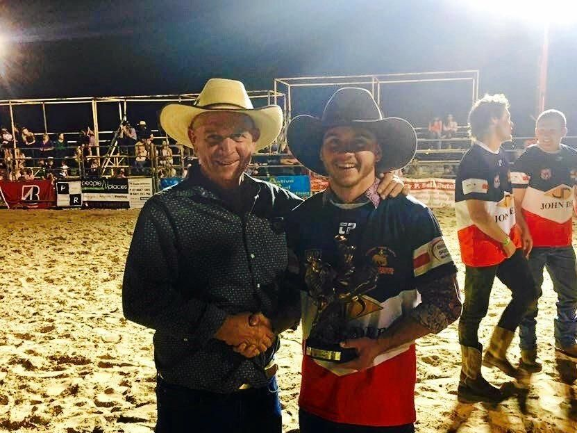 Footballers steer ride winner Harry Sullivan (right) with his father Mark Sullivan who was one of the volunteers at the rodeo.