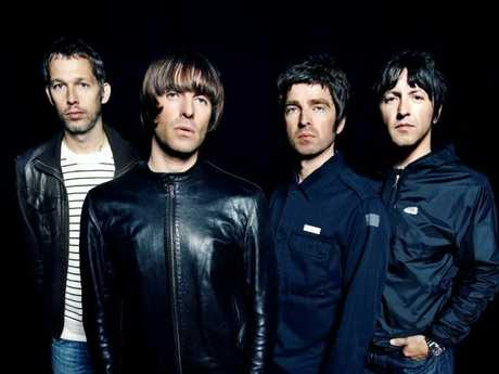 Singer Liam Gallagher and his musician brother Noel are flanked by fellow members of band 'Oasis'.