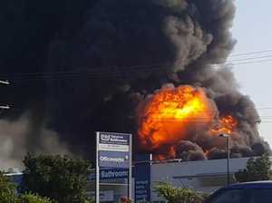 Fire engulfs business as police enforce exclusion zone