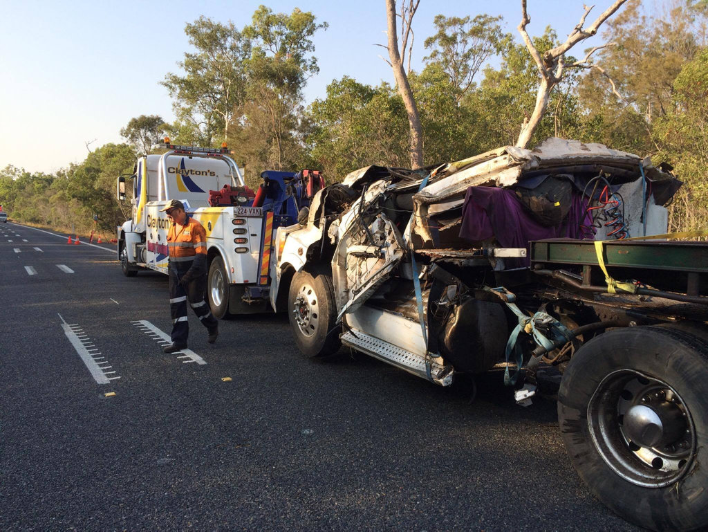 A tow truck is working to remove the wreckage from last night's truck fatality on the Bruce Hwy at Gin Gin.