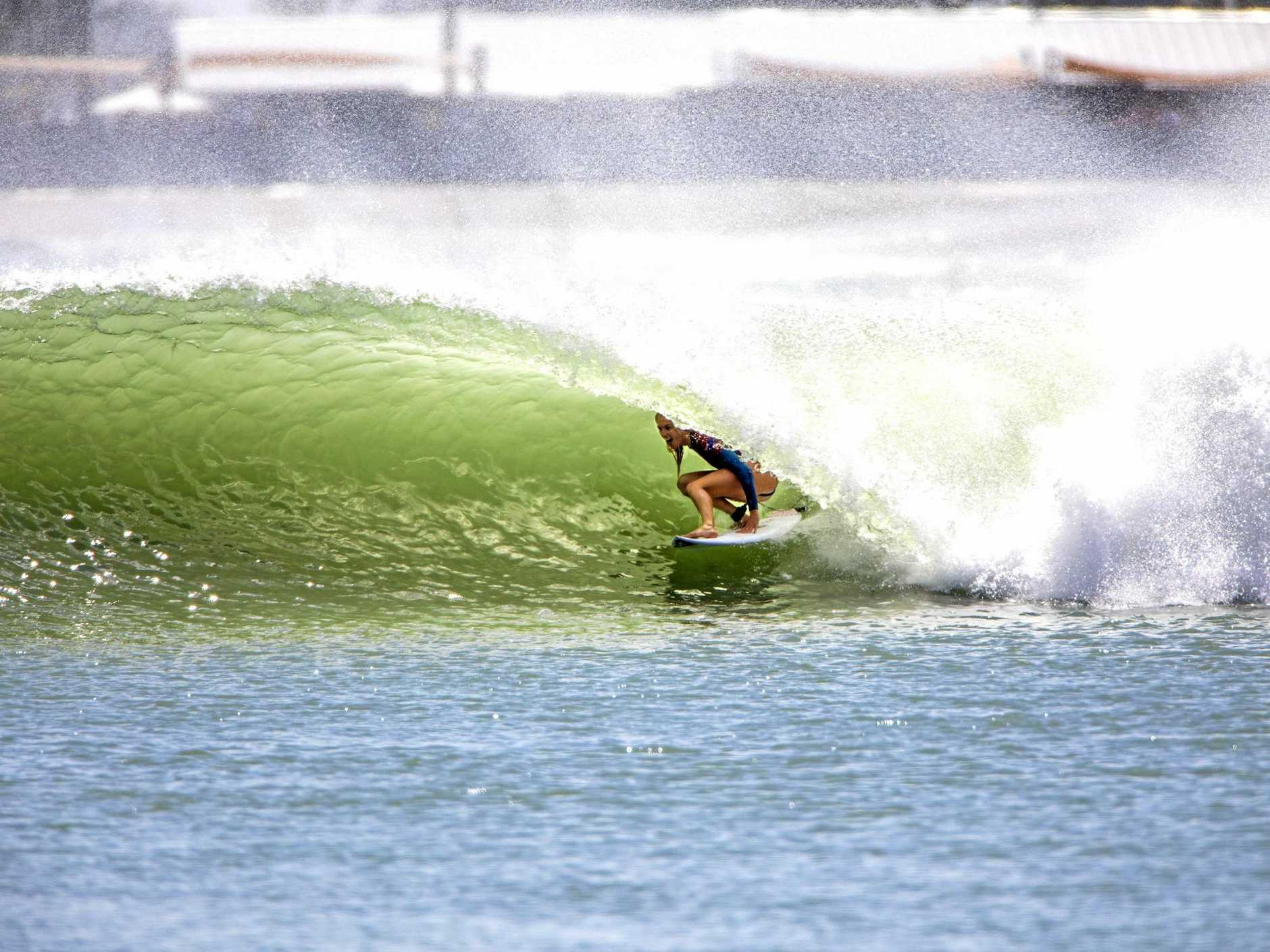 Six-time world champion Stephanie Gilmore gets cheeky with a cheater five inside the wave pool barrel at Kelly Slaters Surf Ranch at Lemoore, California.