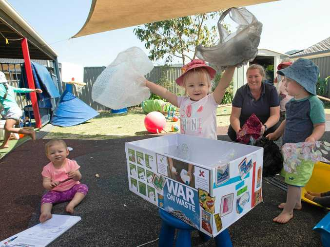 WAR ON WASTE: Poppy and Tyler at Cow and Koala Professional Child Care do their bit for the environment.