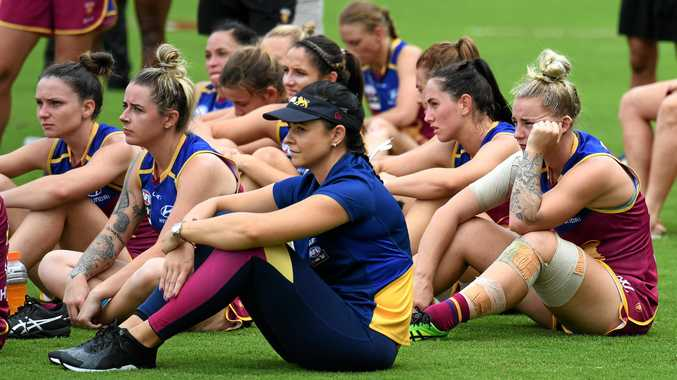 Brisbane Lions players react after losing the AFLW Grand Final game to the Adelaide Crows at Metricon Stadium in Carrara on the Gold Coast, Saturday, March 25, 2017.
