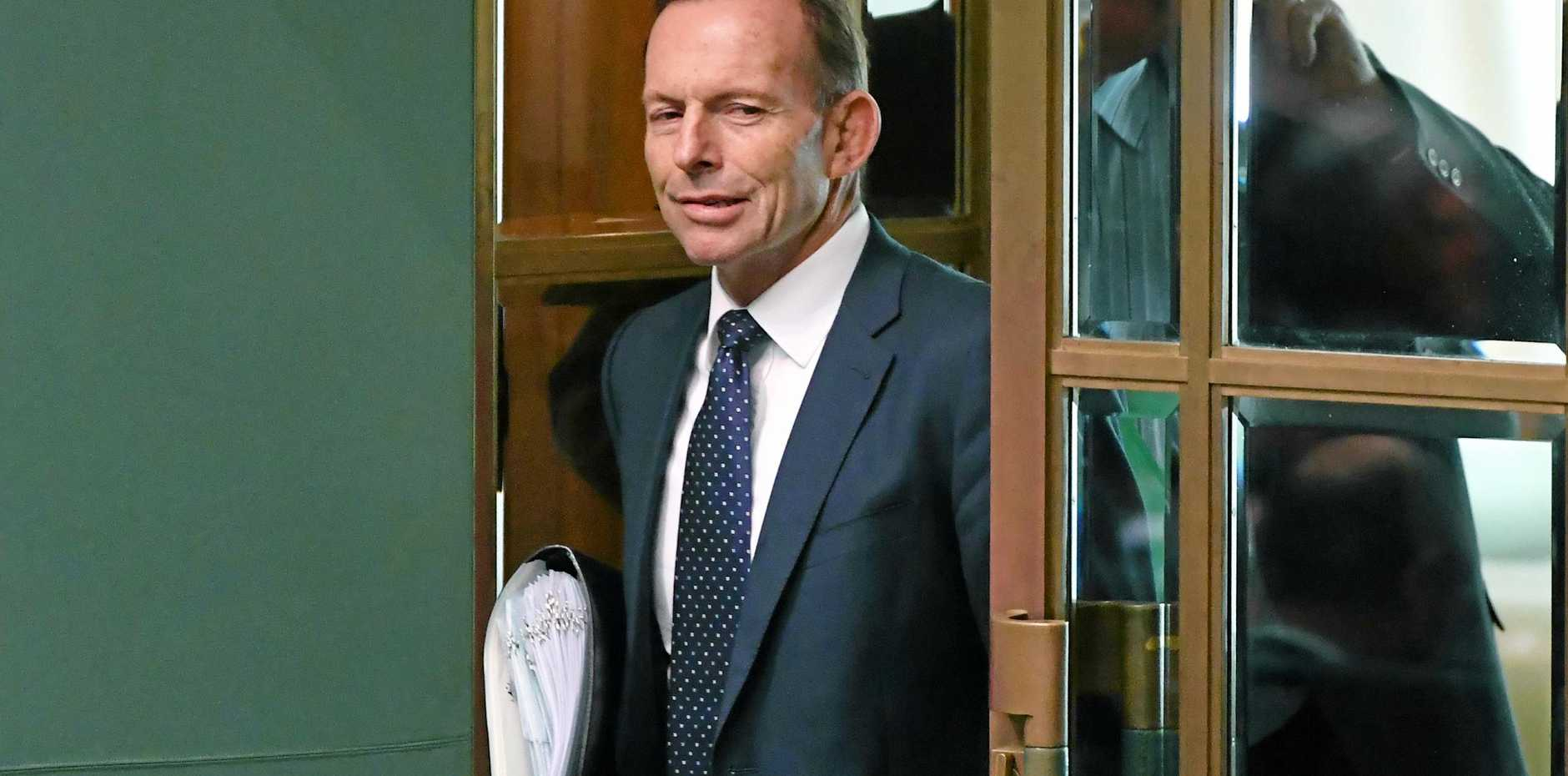 Tony Abbott arrives for Question Time in Parliament.