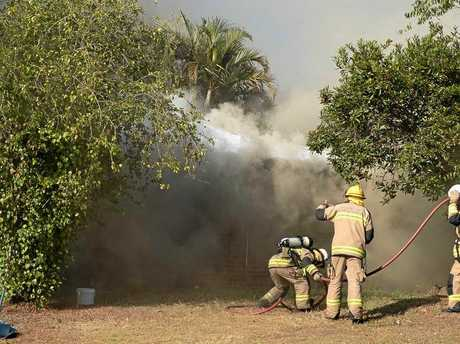 Firefighters battle the house fire at Aroona on September 25.