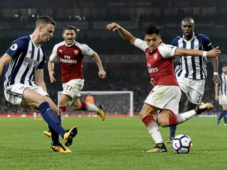 Arsenal's Alexis Sanchez (right) under pressure from West Bromwich Albion's Jonny Evans.