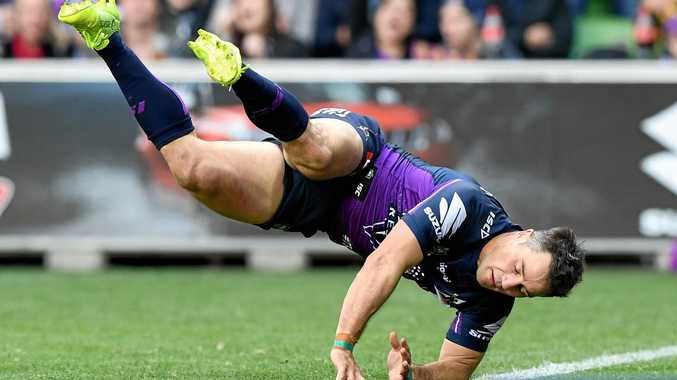 Cooper Cronk of the Storm dives as he scores a try in round 21 against the Sea Eagles.