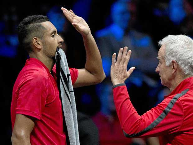 Team World captain John McEnroe (right) high-fives Australian Nick Kyrgios during the Laver Cup in Prague.