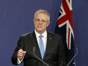 Australian Treasurer Scott Morrison makes a point on the budget deficit during a media conference in Sydney.