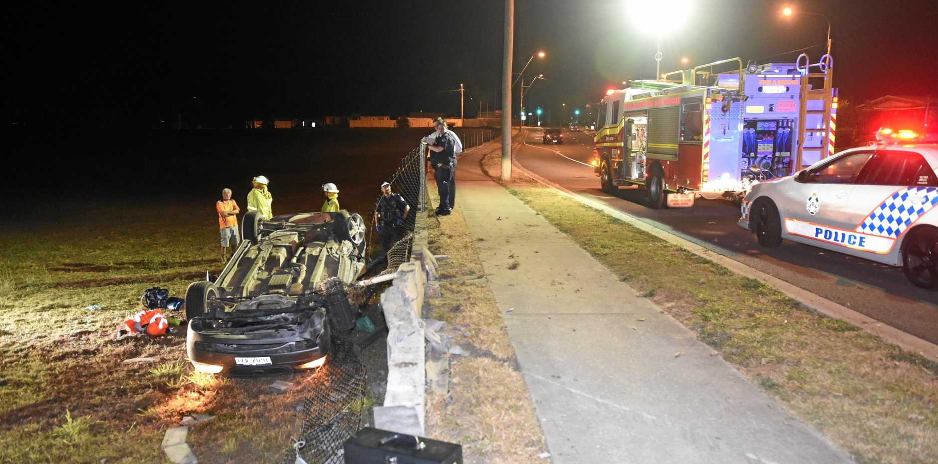 CRASH SCENE: The car hit the gutter, flipped and came to rest in a paddock.
