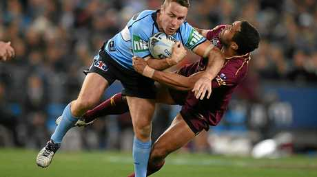 James Maloney of the Blues is tackled by Justin O'Neill of the Maroons during State of Origin game three in 2016.