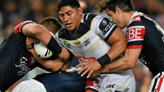 Jason Taumalolo of the Cowboys runs into the Roosters defence during the preliminary final.