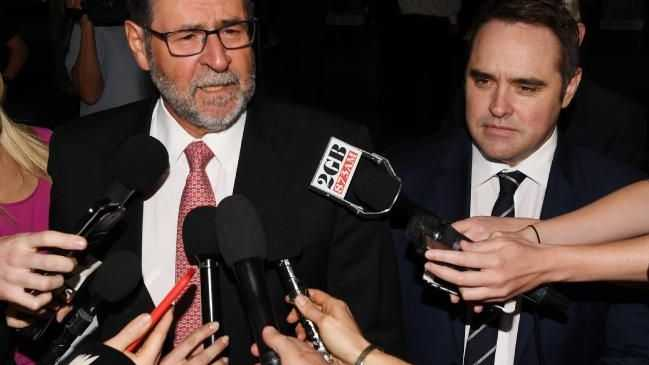 Ben McCormack (right) looks on as his lawyer, Sam Macedone, speaks to the media. Picture: AAPSource:AAP