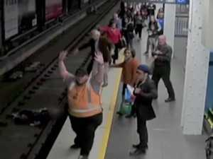 Man saved after falling onto train tracks