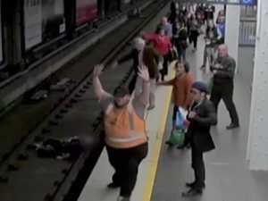 Man saved after falling onto train tracks