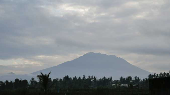 Mount Agung is seen from a nearby village in Karangasem, Bali, Indonesia, 24 September 2017. The Center for Vulcanology of Geological Hazard Mitigation (PVMBG) raised the alert level of Mount Agung to the highest level on 22 September. About 40,000 people have already been evacuated from their homes around the mountain.