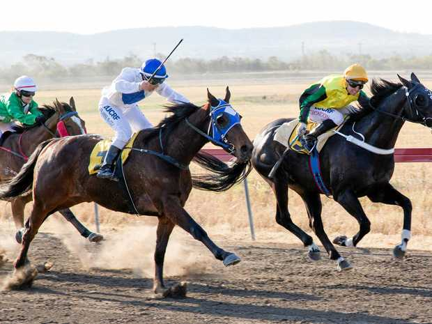DOWN THE STRAIGHT: King Ludwig gets in front Gud Onya to win the Taroom Cup at the weekend.