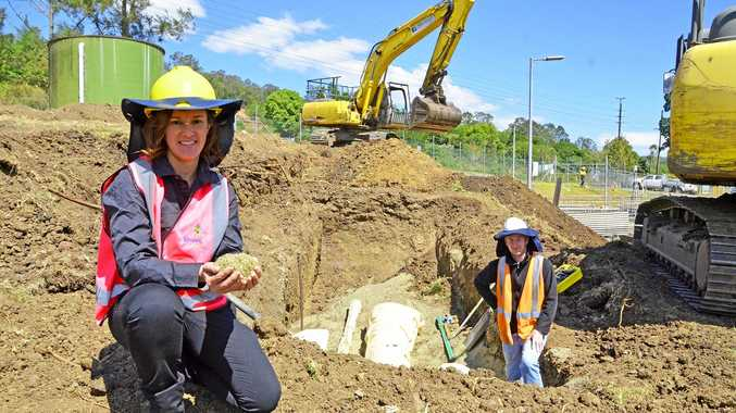 STP recycled glass: Council's Business Development Coordinator Danielle Hanigan and Stirloch Constructions Project Engineer Shane Mangan with the recycled glass being used as pipe bedding at the South Lismore Sewage Treatment Plant.