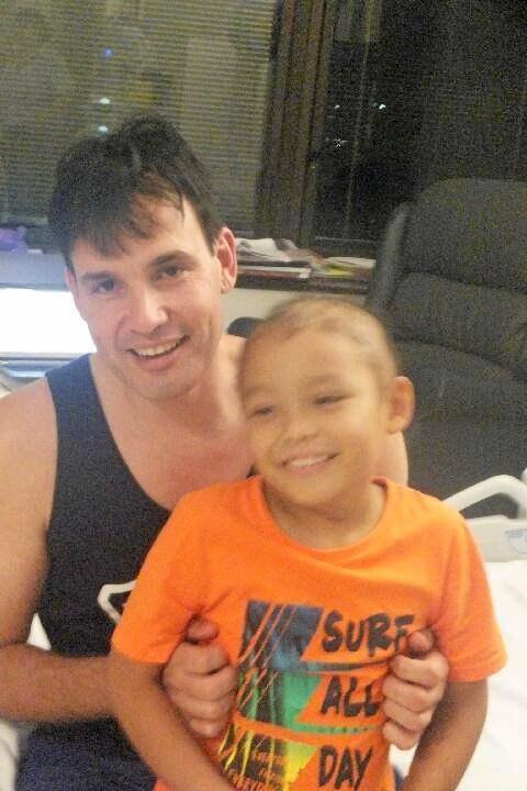Fighter: Micah Murdoch, 6, with his dad, Jason.