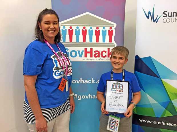 GOV HACK: Matthew Harris accepting the Spirit of GovHack award during the GovHack weekend. Matthew and GovHack staff member Elisha Dibben.