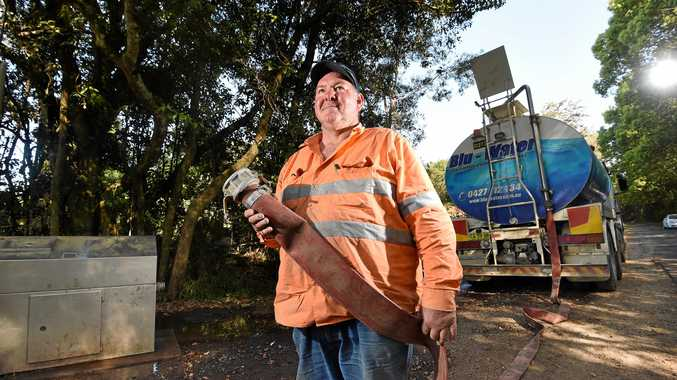 FLAT-OUT: Blu-Water employee Rowan Weir collects more water for his deliveries around the Northern Rivers after residents wait in dire need of rain to fill their water tanks.