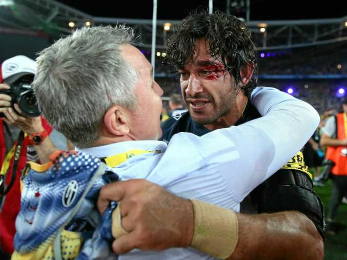 GLORY DAY: Cowboys coach Paul Green and Johnathan Thurston celebrate after the 2015 grand final win.