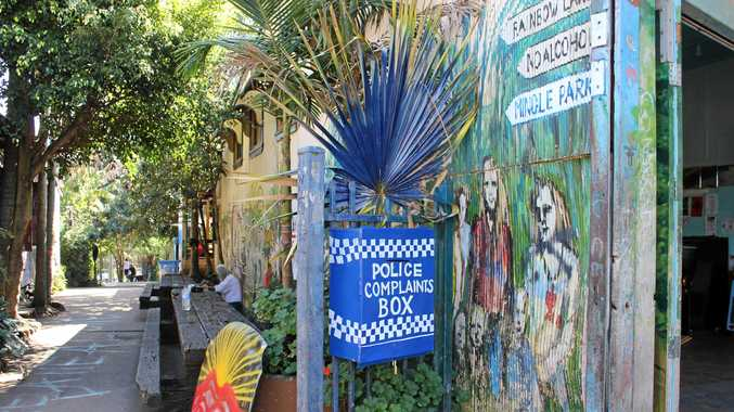 A police complaints box has been erected at the top of Rainbow Lane in Nimbin.  Photo Rudi Maxwell / Northern Rivers Echo