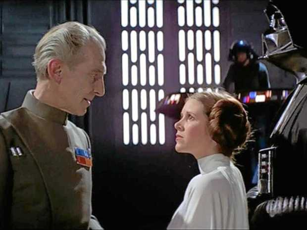 ICONIC: Peter Cushing, Carrie Fisher and David Prowse in a scene from the movie Star Wars Episode IV - A New Hope.