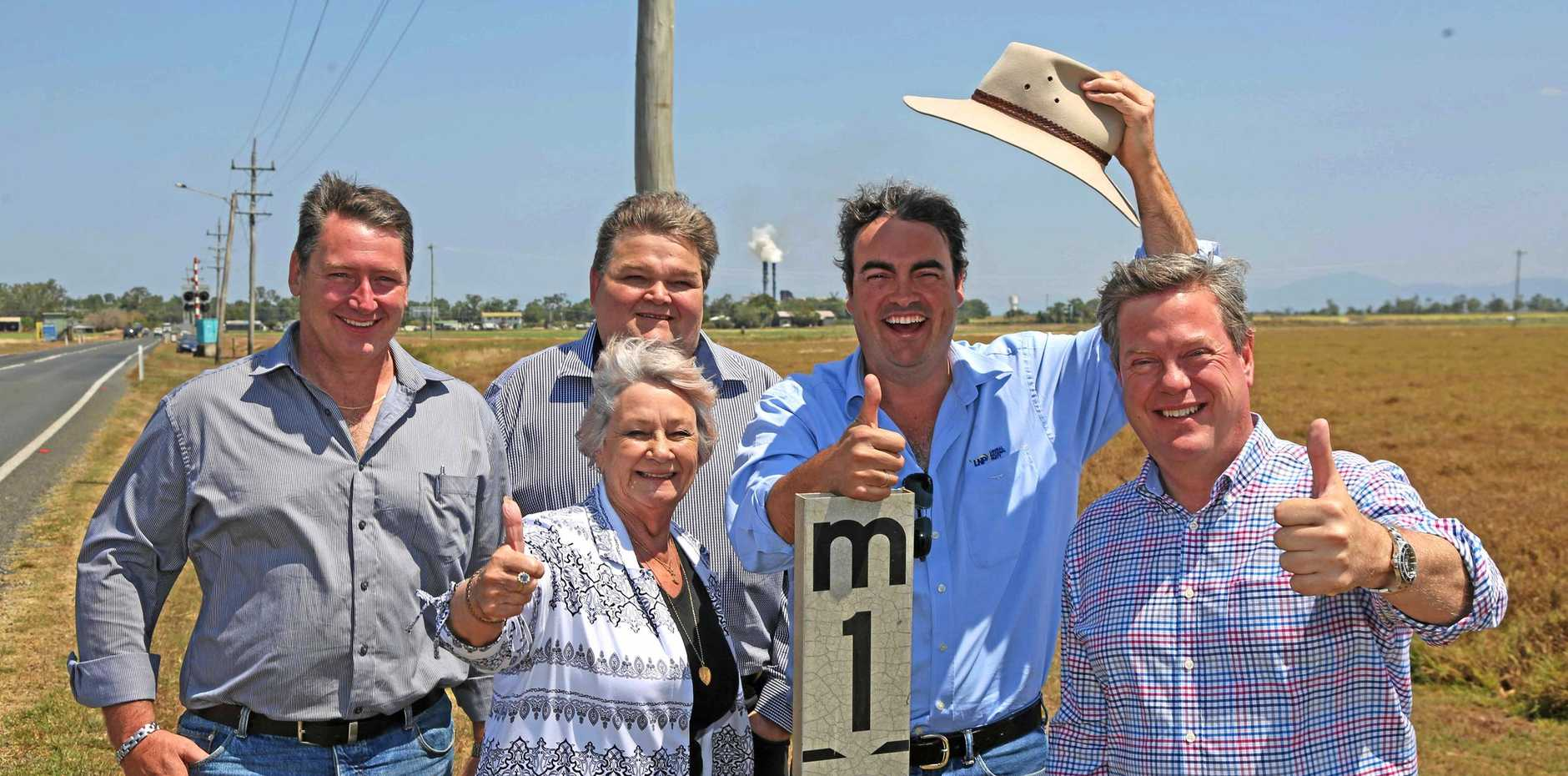 Whitsunday Regional councillors, Ron Petterson, Jan Clifford and deputy mayor John Collins with member for Whitsunday Jason Costigan and Opposition leader Tim Nicholls celebrate a LNP promise to flood proof Hamilton Plains.