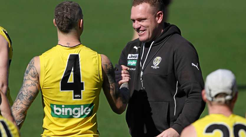 HAVING FUN: Justin Leppitsch shares a joke with Dustin Martin.