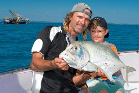 Mick and Reef Underwood with the little guy's biggest tea leaf trevally to date.