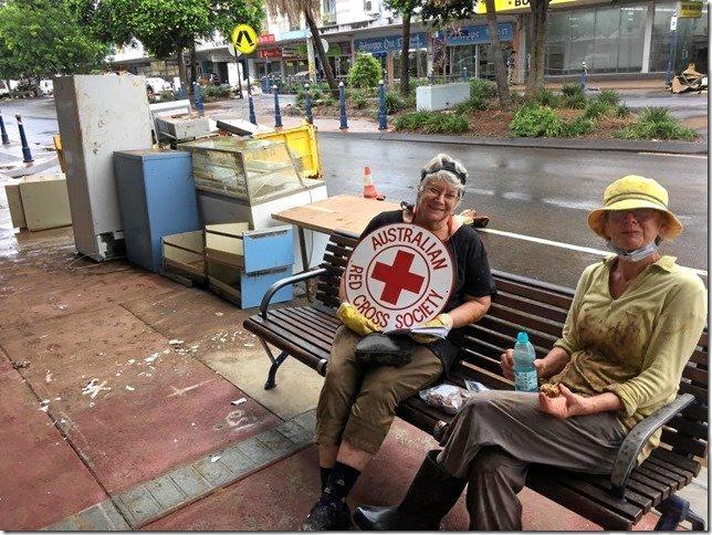 Two Lismore Red Cross volunteers looking