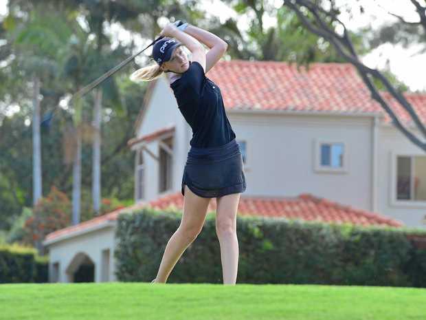 RISING STAR: Sunshine Coast Junior Masters golf winner Cassie Porter drives at Noosa Springs golf club.