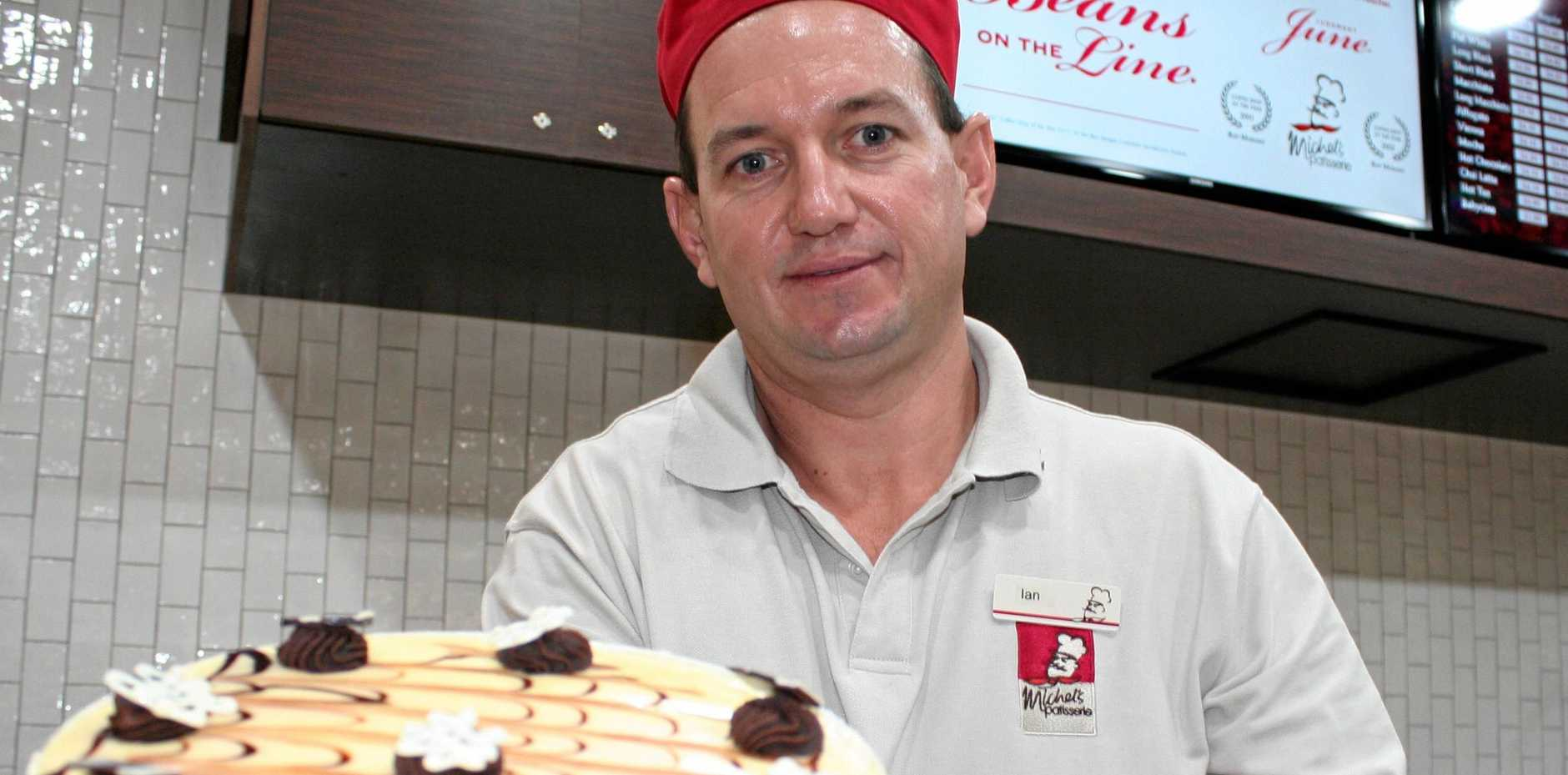SLICE AND SERVE: Michel Patisserie owner/manager puts forward his most delicate and decadent mud swirl cake. Austin King / The Morning Bulletin