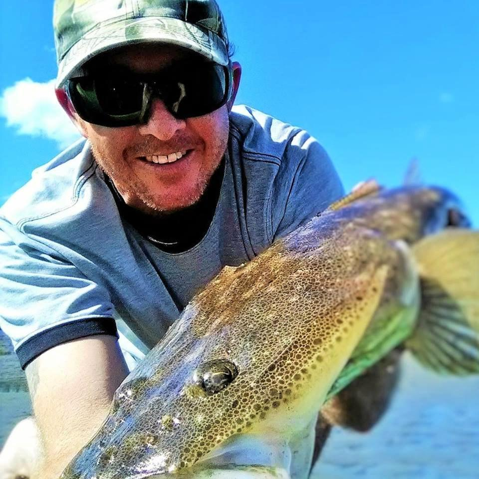 GOTCHA: Dean Tomlinson with a nice dusky flathead caught and released like all his fish are, in the lower Maroochy River.