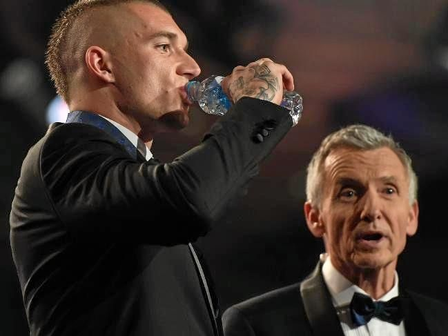 Dustin Martin on stage with Bruce McAvaney at the Brownlow Medal.