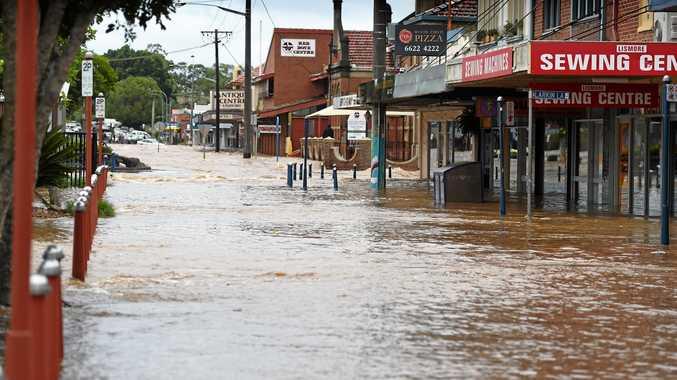 Heavy flood water tears through the Lismore CBD.