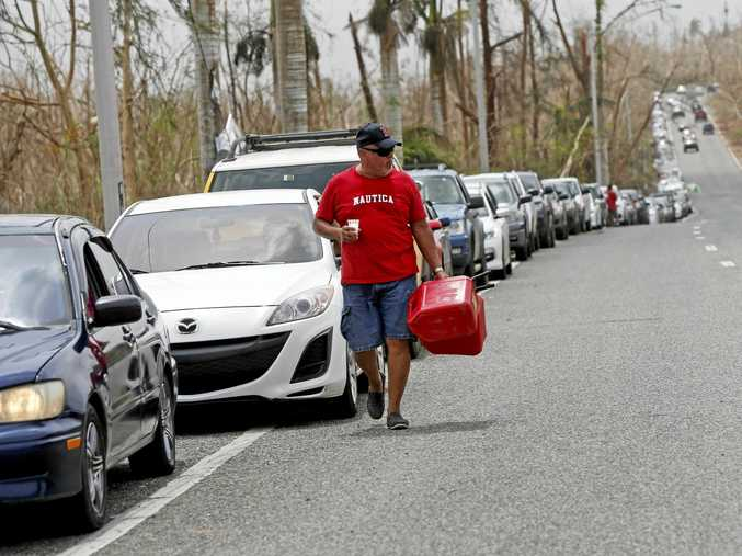 Puerto Ricans queue to buy petrol a week on from Hurricane Irma.