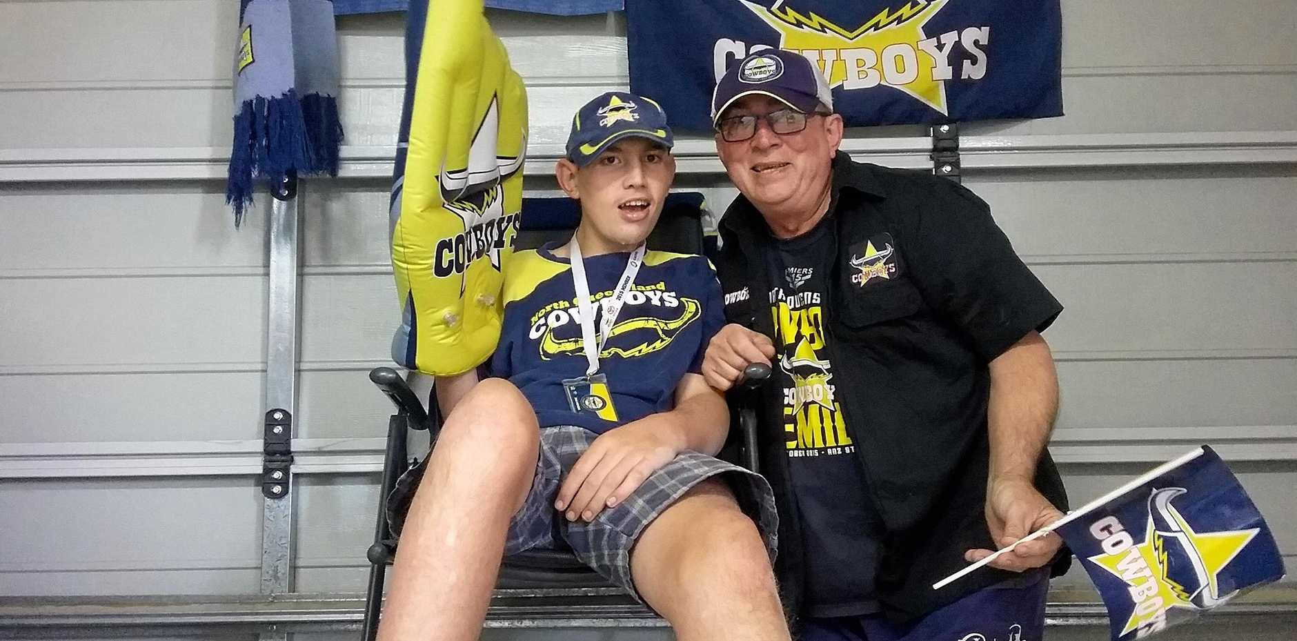 GARRY Taylor, right, with son Kenny of Pacific Paradise haven't jumped on a bandwagon to back the Cowboys. They've been with the club from the start and are in Sydney for the grand final