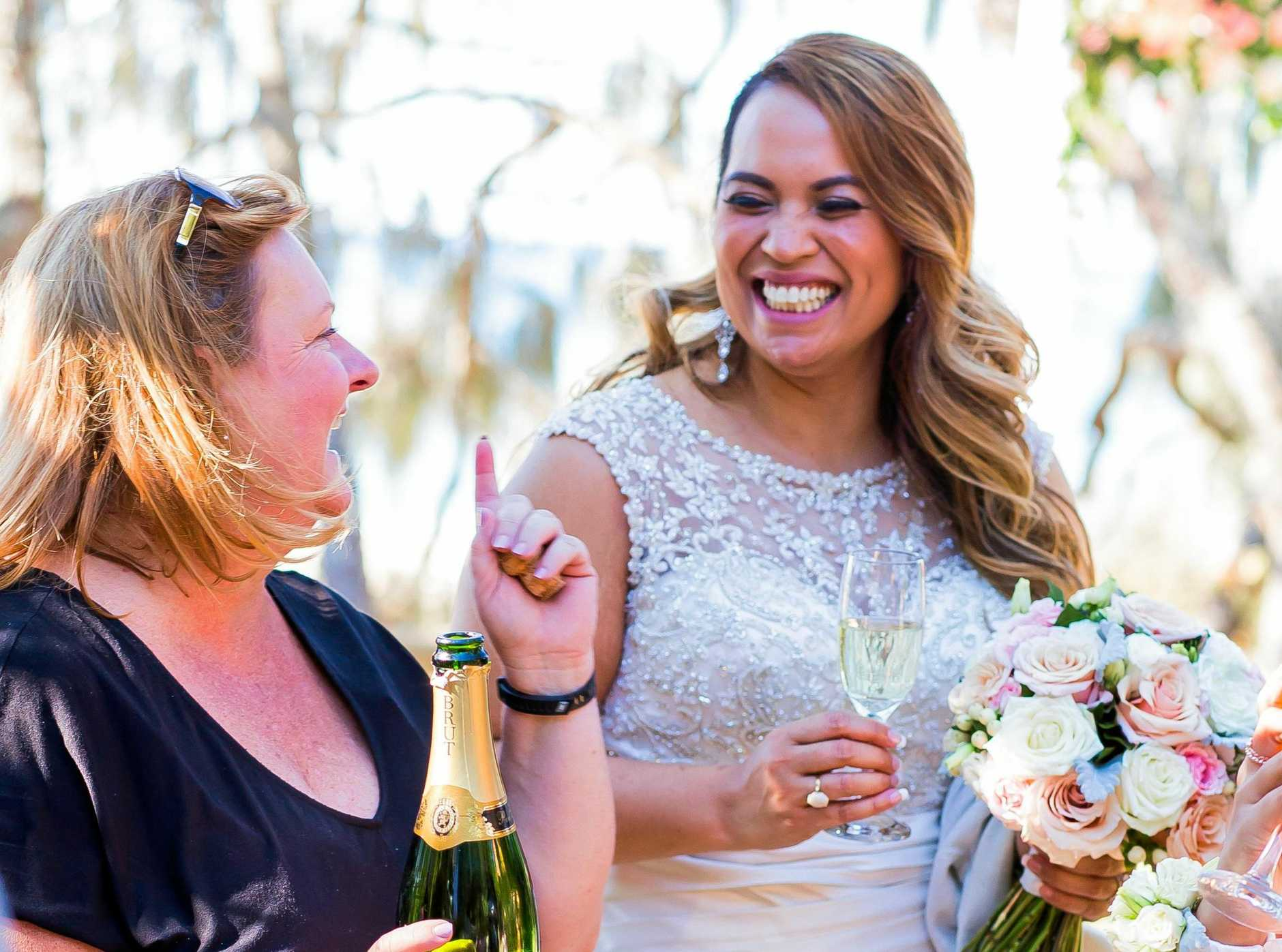 Wedding planner Julie-Ann Brown, pictured with one of her brides, welcomes the legalisation of same-sex marriage and the boost it would bring to the Sunshine Coast wedding industry.